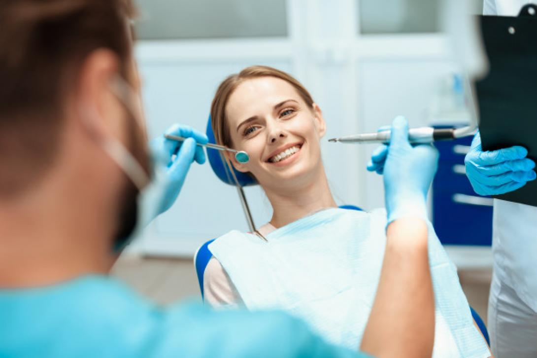 woman-sits-dental-chair-doctors-bowed-her_85574-6621-1090px