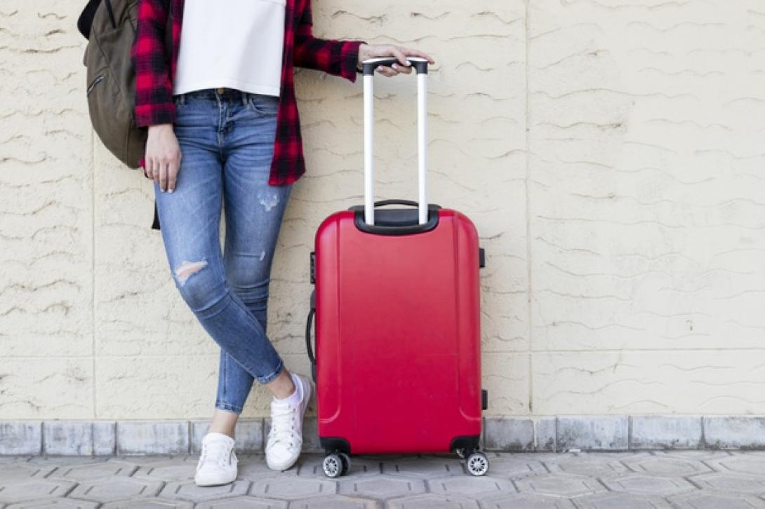 standing-traveller-woman-with-luggage_23-2148258815-1090px